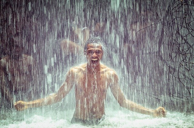 man-under-waterfall-2150164_640