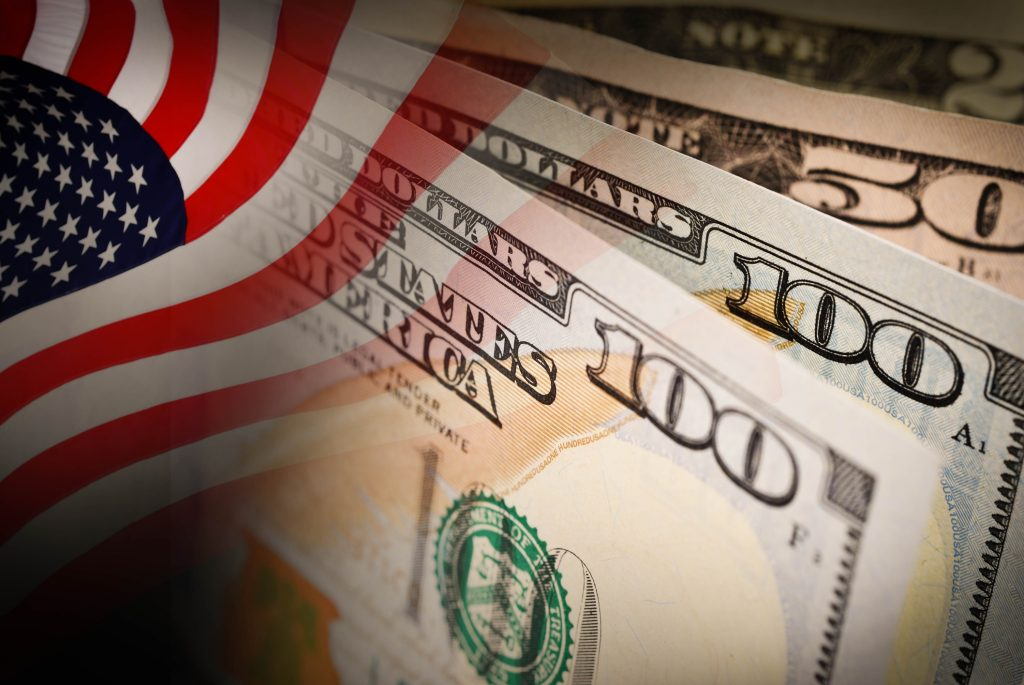 American flag and banknotes (USD) currency money background