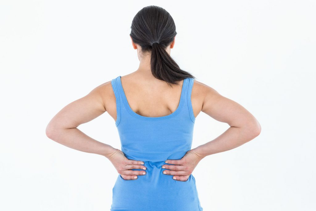 39791054 - pretty brunette suffering from back pain on white background